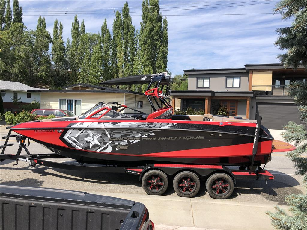 Nautique G25 REDUCED 550hp, custom stereo, upgraded ballast